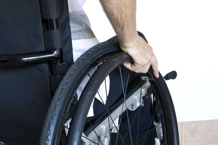disable:  propelling herself in wheelchair