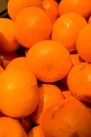 Mandarins piled for sale at fresh food market