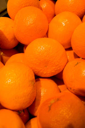 Mandarins piled for sale at fresh food market
