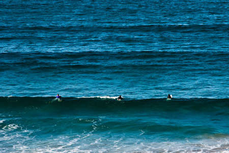 Surfers in pacific ocean waiting for a wave