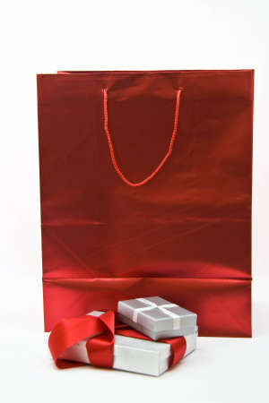 Red gift bag and silver gift boxes