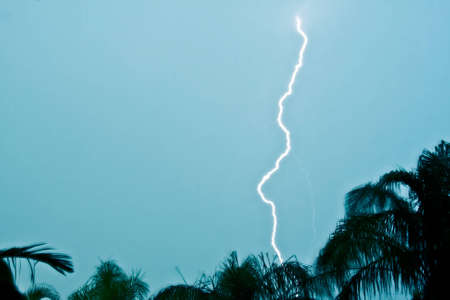 Lightning strike in the afternoon Stock Photo