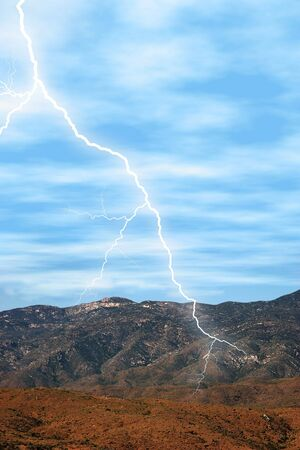 bolt: Lightening striking in the desert mountains.