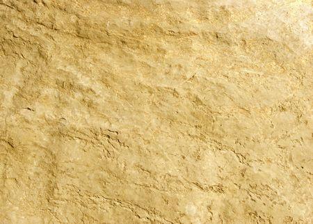 Gold rock texture shot close-up at shallow dof.