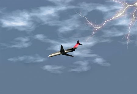 Airplane getting ready to land in the midst of a lightening storm. Stock Photo