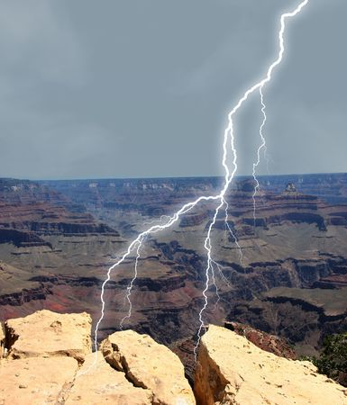 Lightening striking at Grand Canyon near rock outcroppings.