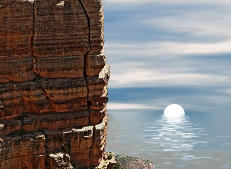 View of sun setting with huge rock in foreground. Stock Photo - 567211