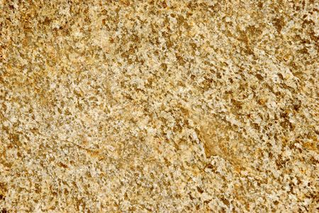 Speckled gold rock texture shot close-up at shallow dof. Stock Photo - 567225