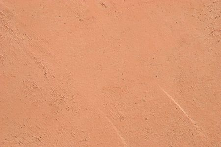Picture of a peach colored bumpy stucco wall. Stock Photo