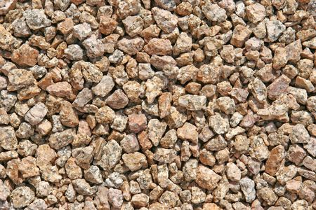 Close-up of brown and gray rocks speckled with granite.
