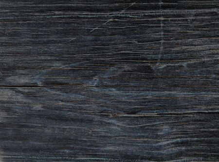 Close-up of an old black wooden plank. Stock Photo