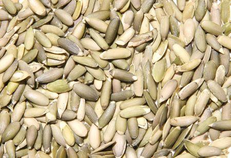 Close-up of hulled raw pumpkin seeds. Stock Photo