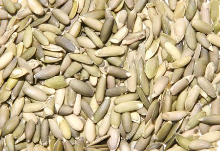 Close-up of hulled raw pumpkin seeds. Stock Photo