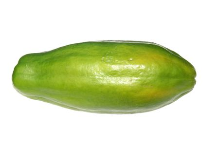 Close-up of a green Caribbean papaya isolated over white.