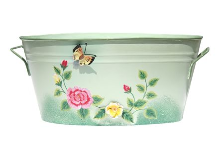 Isolated close-up of green tin bucket decorated with a butterfly and flowers.