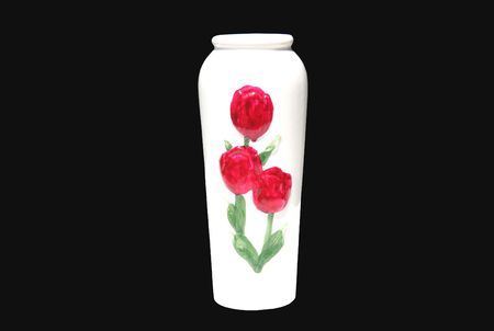 Close-up of white vase decorated with red tulips over black. Stock Photo
