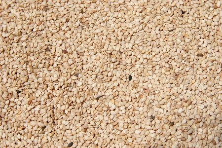 Close-up of hulled raw sesame seeds. Stock Photo
