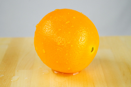 Orange with white background Reklamní fotografie