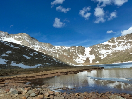 mount evans: View of colorado mountains with water, blue skies and clouds