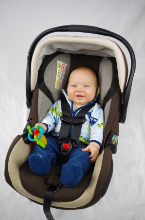 safely: baby buckled safely in carseat