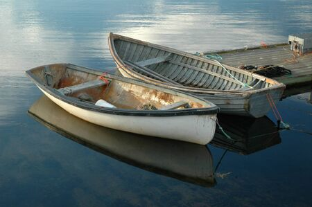 with reflection: Two boats at Peggys Cove, Nova Scotia Stock Photo