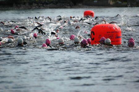 britannia: Triathlon swimmers going around the marker buoys. Ottawa Riverkeeper Triathlon 2009. Editorial