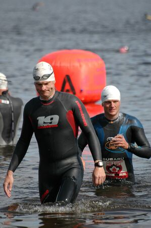 britannia: Swimmers leave the water after the warm-up. Ottawa Riverkeeper Triathlon 2009 Editorial