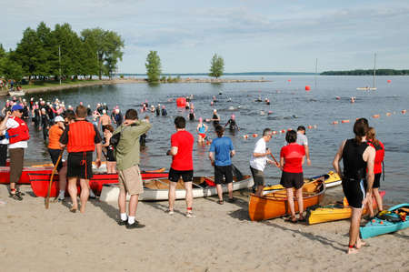 Swimmers warming up before the triathlon start. Safety boat operators and spectators look on. Ottawa Riverkeeper Triathlon 2009