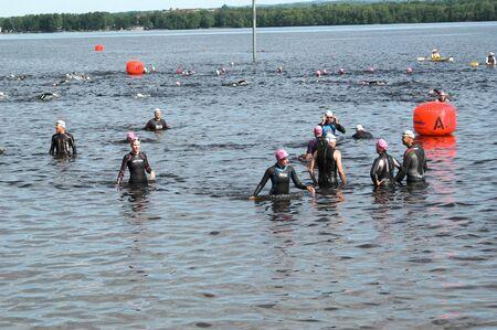 Warming up before the swimming portion of the triathlon. Ottawa Riverkeeper Triathlon 2009 Editorial