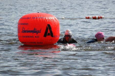 Swimmers passing a buoy at the Ottawa Riverkeeper Triathlon 2009. Stock Photo - 10274068