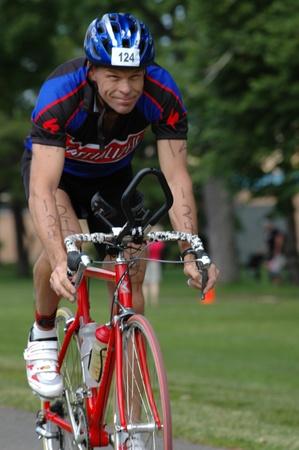 Man cycling in the second leg of the Ottawa Riverkeeper Triathlon 2009. Stock Photo - 10274065