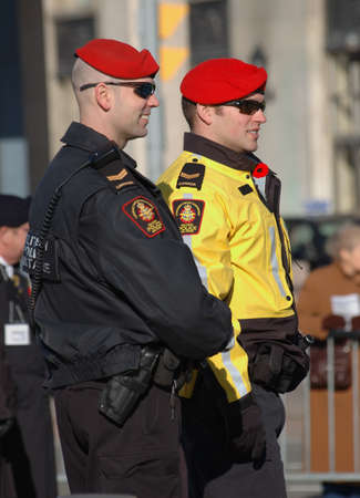 Remembrance Day 2009 - Ottawa, Ontario, Canada - November 11, 2009 - Remembrance Day - two police officers maintaining crowd control Editorial