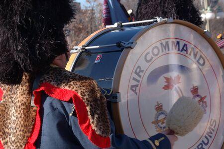 Ottawa, Ontario, Canada - November 11, 2009 - Pipe and Drum Marching Band - Bass Drum Stock Photo - 10781647