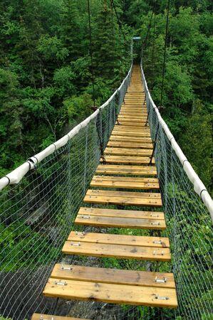 White River Suspension Bridge, Pukaskwa National Park, Marathon, Ontario.  Stock Photo
