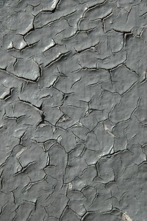 Gray paint cracking and peeling.