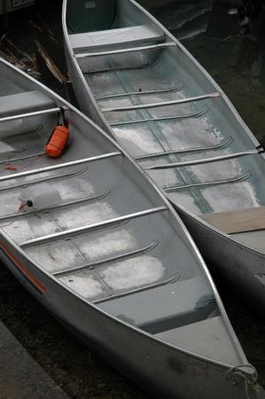 Aluminum canoes at Moraine Lake near Banff, Alberta. Stock Photo