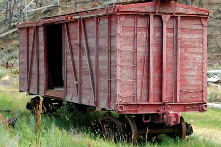 Abandoned red freight car in the badlands of Alberta near Drumheller.