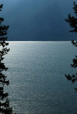 Interesting lighting effects on Kootenay Lake in British Columbia  Фото со стока