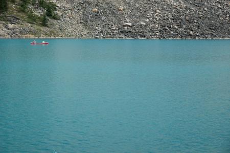 Distant canoe at Moraine Lake near Banff, Alberta.
