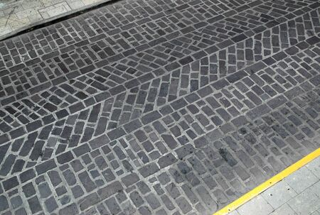 road surface: Textured pattern in the stone road surface in Oaxaca, Mexico.
