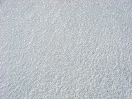 Textured snow from above. Overhead low-level aerial shot of snow on a beach near the Ottawa River shoreline at Westboro Beach in January. This picture was taken from a camera rig suspended below a kite (Kite Aerial Photography - KAP).