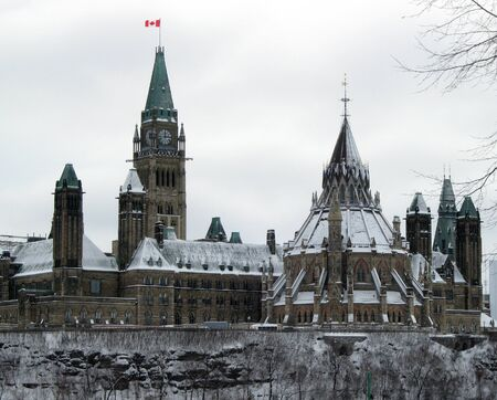Parliament Hill in the Snow. The Canadian Houses of Parliament showing the Peace Tower and the circular Canada