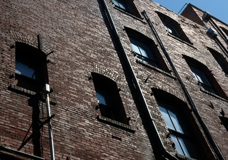 Upward view of historic old building in Seattle Washington. Shot taken in a back alley.