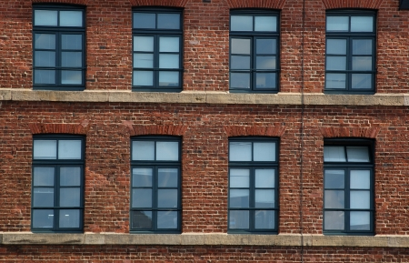 industry: Windows and brick in an old industrial building near the Royal Armouries Museum in Leeds, UK. Stock Photo
