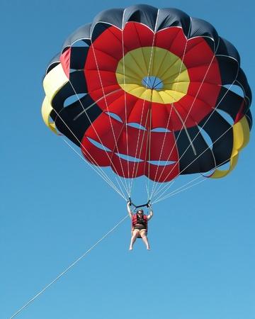 parasailing: Woman Parasailing at Punta Cana, Dominican Republic. Editorial
