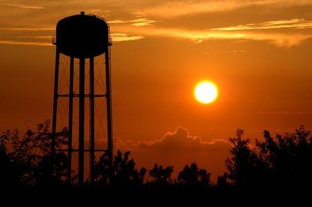 Kansas Sunset. Water tower silhouetted in the sunset east of Seneca, Kansas.