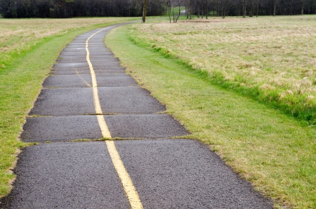 Bicycle path that has aged and showing need of repair