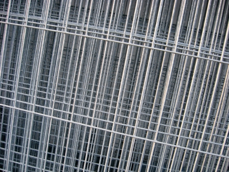 A leaning stack of meshed wire  Fencing or concrete reinforcement material  Stock Photo