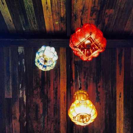 adore: Bright colored lanterns adore this wooden ceiling in a restaurant in Tagaytay Philippines