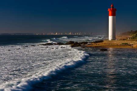 Umhlanga Lighthouse with Durban cityscape as  photo